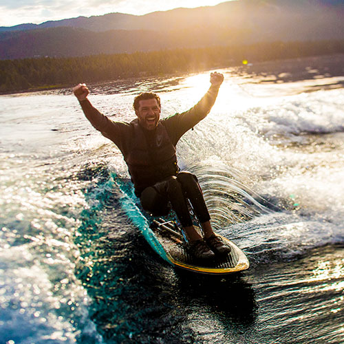 rhinohub client grant korgan riding a wave